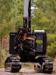 Mobile crane lifting logs